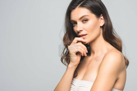Photo for Portrait of attractive tender brunette woman, isolated on grey - Royalty Free Image