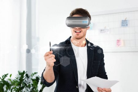 Photo pour Businessman in shirt with virtual reality headset with search bar illustration holding pen and papers - image libre de droit