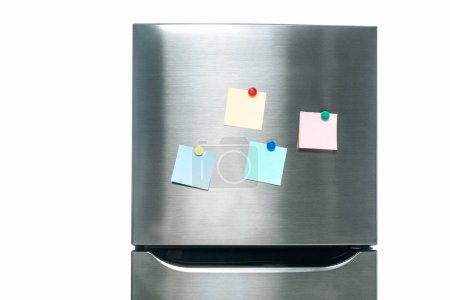 Photo for Stainless steel fridge with blank sticky notes on freezer isolated on white - Royalty Free Image