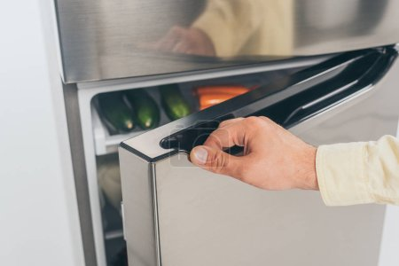 Photo for Cropped view of man open fridge door - Royalty Free Image