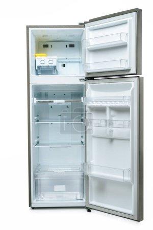 Photo pour Empty open fridge and freezer isolated on white - image libre de droit