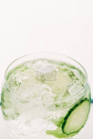 Photo for Close up view of fresh gin and tonic with cucumber slices isolated on white - Royalty Free Image