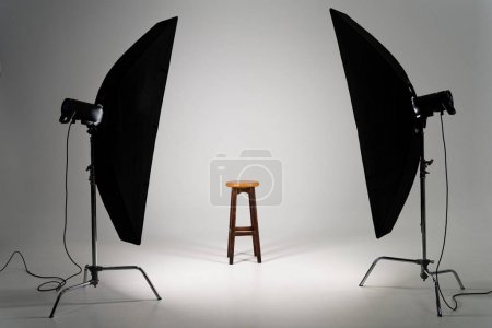 Photo for Wooden stool with studio light on grey background - Royalty Free Image