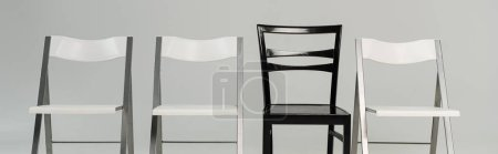 Photo for Black and white chairs isolated on grey, panoramic shot - Royalty Free Image