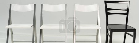 Photo for Panoramic shot of white and black chairs on grey background - Royalty Free Image