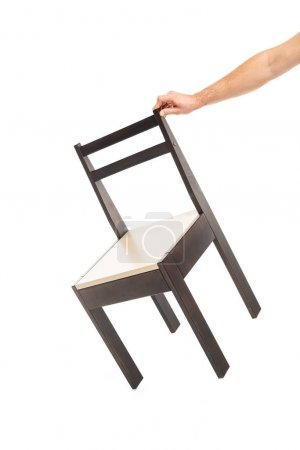 Cropped view of man holding brown wooden chair isolated on white