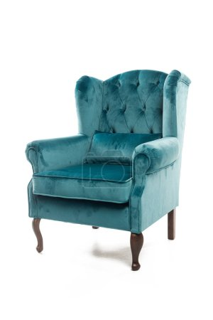 Turquoise armchair with velvet pillow isolated on white