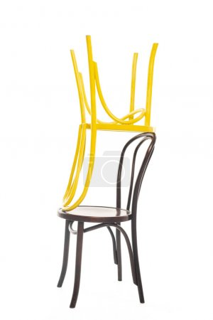 Yellow and brown wooden chairs isolated on white
