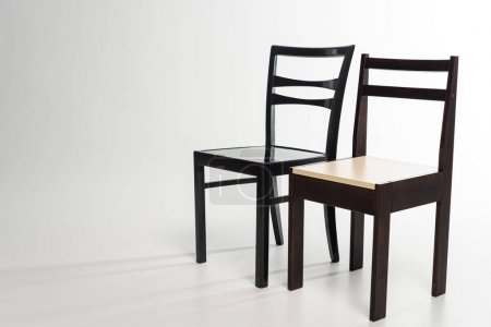 Photo for Two modern wooden chairs on grey background - Royalty Free Image