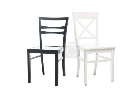 Photo pour Chaises en bois noir et blanc isolées sur blanc - image libre de droit