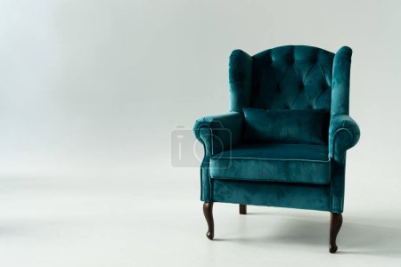 Photo for Comfortable turquoise armchair on grey background - Royalty Free Image