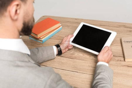 Photo for Cropped view of businessman holding digital tablet with blank screen isolated on grey - Royalty Free Image
