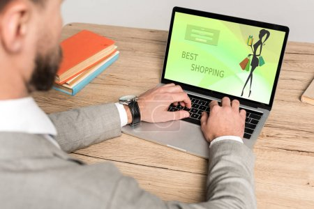 Photo for Cropped view of businessman using laptop with best shopping website on screen isolated on grey - Royalty Free Image