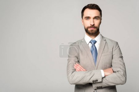 Photo for Confident businessman standing with crossed arms and looking at camera isolated on grey - Royalty Free Image