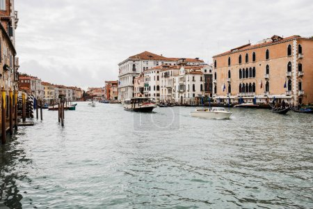 VENICE, ITALY - SEPTEMBER 24, 2019: motor boats with tourists floating on grand canal in Venice, Italy
