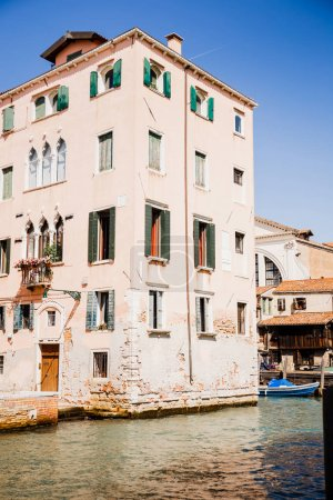 view of ancient building near canal in Venice, Italy