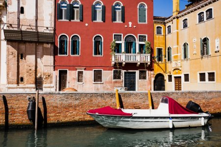 Photo for Motor boat near bright and colorful buildings in Venice, Italy - Royalty Free Image