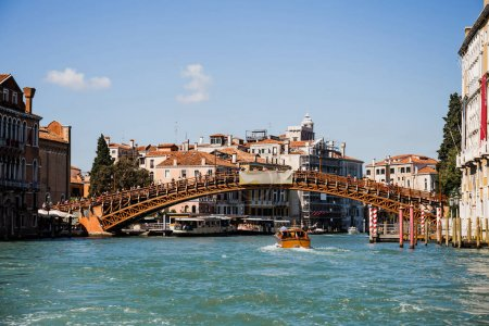 Photo for VENICE, ITALY - SEPTEMBER 24, 2019: vaporetto floating under Accademia bridge in Venice, Italy - Royalty Free Image