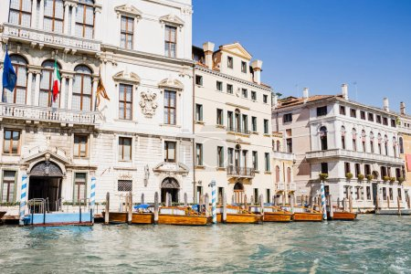 river with motor boats near ancient buildings in Venice, Italy