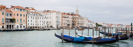 Photo for Panoramic shot of canal with gondolas and ancient buildings in Venice, Italy - Royalty Free Image