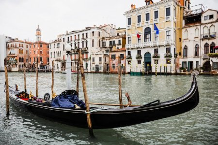Photo for Canal with gondola and ancient buildings in Venice, Italy - Royalty Free Image