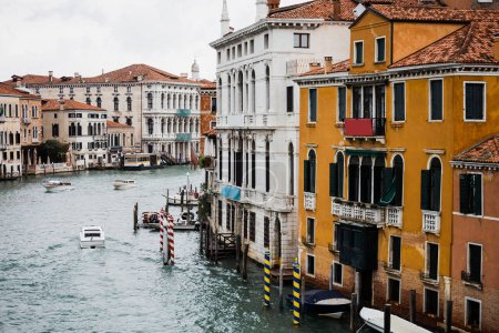 Photo for Vaporettos floating on canal bear ancient buildings in Venice, Italy - Royalty Free Image