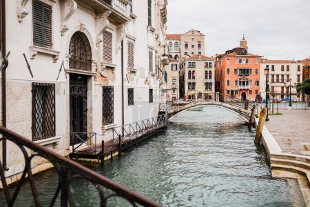 Photo for Bridge above canal near ancient buildings in Venice, Italy - Royalty Free Image