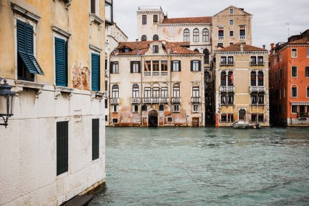 Photo for Ancient and colorful buildings and canal in Venice, Italy - Royalty Free Image