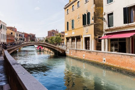 Photo for VENICE, ITALY - SEPTEMBER 24, 2019: bridge above canal and ancient buildings in Venice, Italy - Royalty Free Image