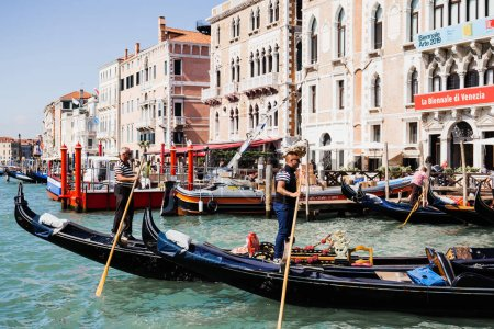 Photo for VENICE, ITALY - SEPTEMBER 24, 2019: side view of gondoliers floating on gondolas in Venice, Italy - Royalty Free Image