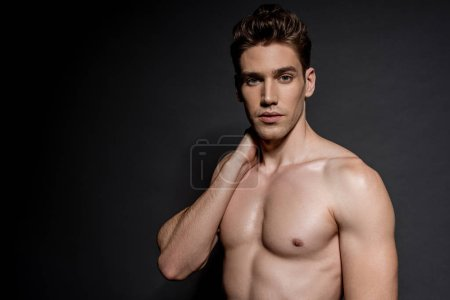 Photo for Sexy young naked man with muscular torso posing on black background - Royalty Free Image