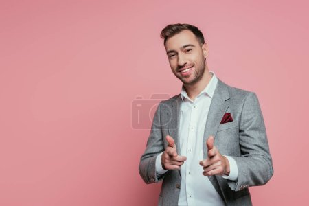 Photo for Cheerful bearded man in grey suit pointing at you, isolated on pink - Royalty Free Image