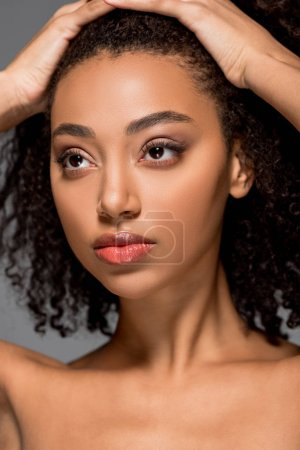 beautiful curly african american girl, isolated on grey