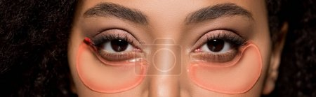 Photo for Panoramic shot of attractive african american girl with hydrogel eye patches - Royalty Free Image