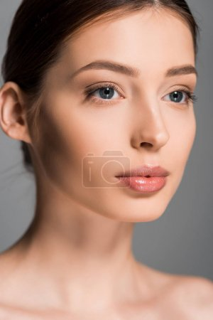 portrait of beautiful girl with perfect skin, isolated on grey