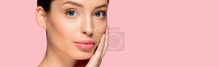 Photo for Panoramic shot of attractive young woman with perfect skin, isolated on pink - Royalty Free Image