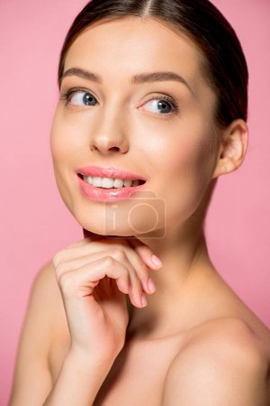 Photo for Portrait of smiling young woman with perfect skin, isolated on pink - Royalty Free Image
