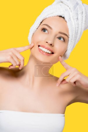 Photo for Naked smiling girl with towel on head, isolated on yellow - Royalty Free Image