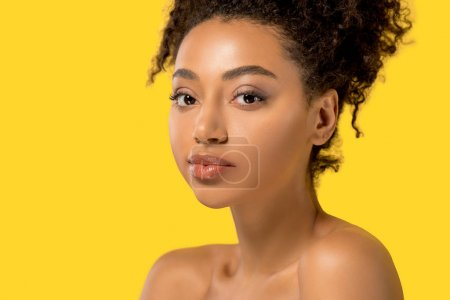 portrait of attractive african american girl with clean skin, isolated on yellow