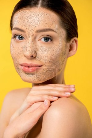 Photo for Beautiful young woman with peeling mask, isolated on yellow - Royalty Free Image
