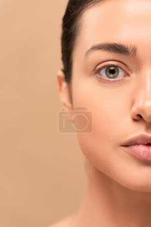 Photo pour Cropped view of girl with clean face looking at camera isolated on beige - image libre de droit