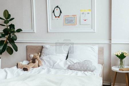 Photo for Interior of empty children room with bed, teddy bear and paintings - Royalty Free Image