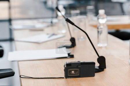 Photo for Selective focus of voice recorder near microphones on table - Royalty Free Image