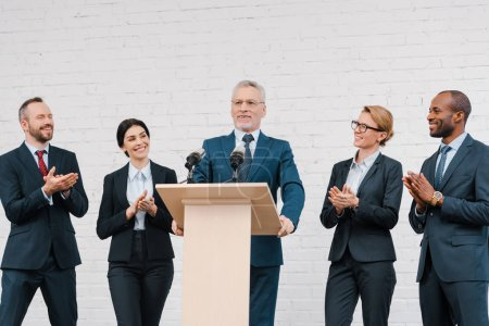 Photo for Multicultural businessmen and businesswomen applauding to bearded speaker - Royalty Free Image
