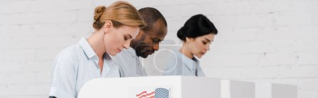 Photo for Panoramic shot of women and african american man voting near brick wall - Royalty Free Image