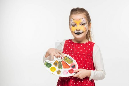 adorable kid with tiger muzzle painting on face holding palette isolated on white