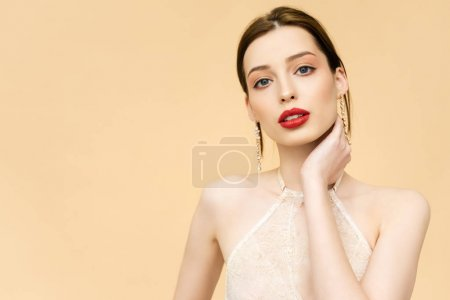 Photo for Young attractive woman looking at camera isolated on beige - Royalty Free Image