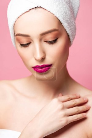 Photo for Young attractive woman in white towel isolated on pink - Royalty Free Image