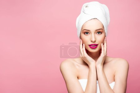 Photo for Beautiful young woman in white towel touching face isolated on pink - Royalty Free Image