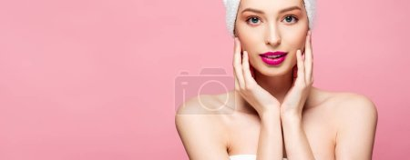 Photo for Panoramic shot of beautiful young woman in white towel touching face isolated on pink - Royalty Free Image
